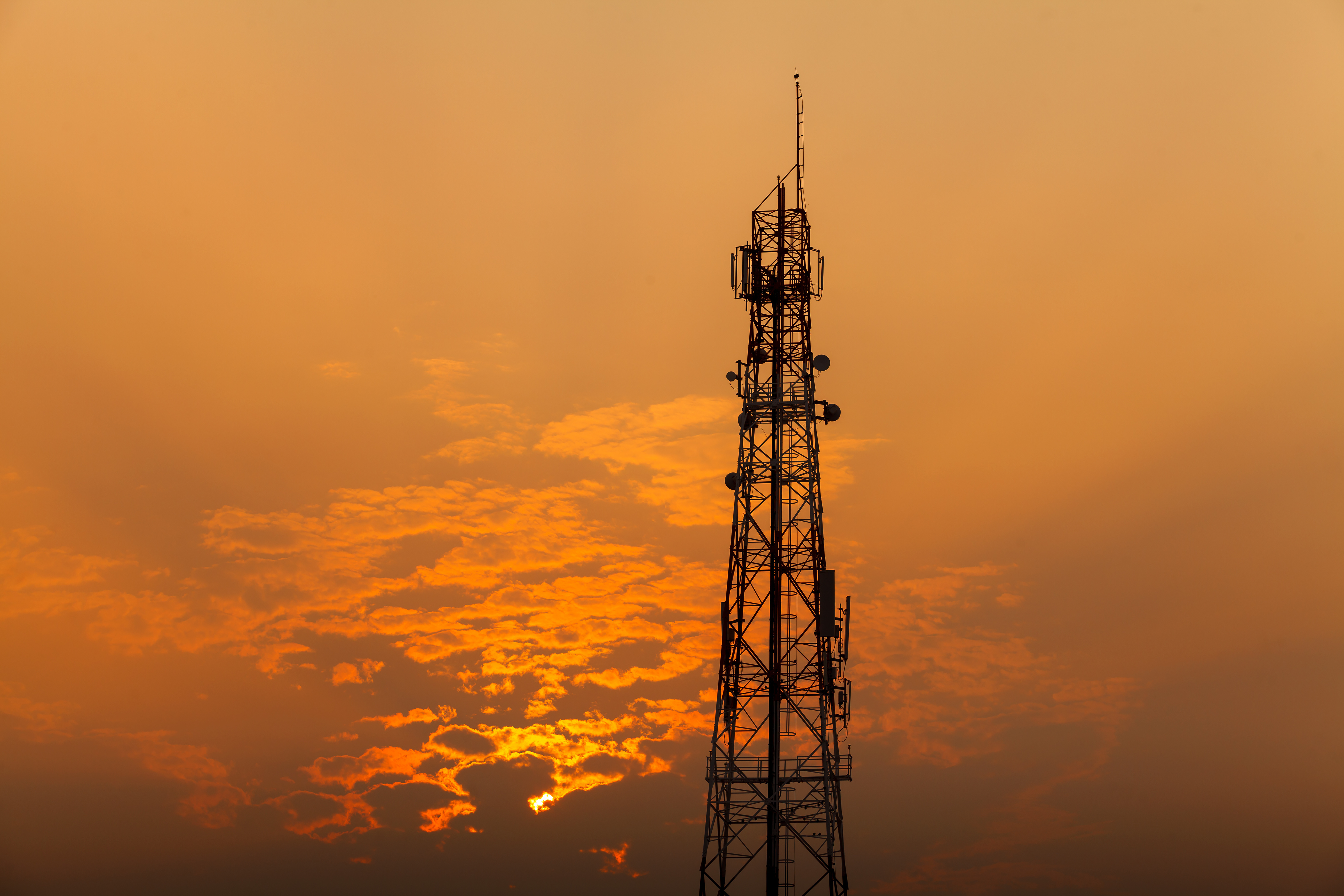 Communication tower during sunset